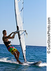 Front view of young windsurfer - Young man surfing the wind...