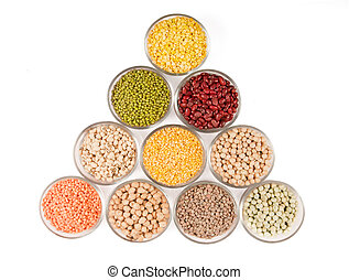 Grains pulses and beans in bowl over white over