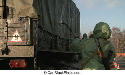 Soldier washing truck - View of military camp