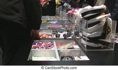 People shopping in the souvenir sho - In the souvenir shop...
