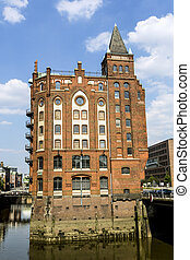 Brick-lined red houses at the Speicherstadt Hamburg -...