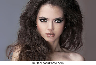 Fashion model woman brunette with curly hair, brown