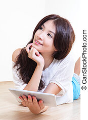 woman smile using tablet pc at home