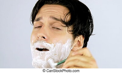 Man shaving closeup - Male model shaving happy with face...