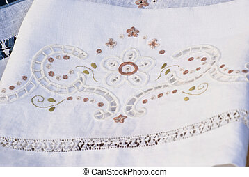 carved and embroidered cloth. handmade.