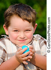 Boy on easter egg hunt