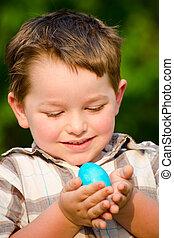 Boy on easter egg hunt