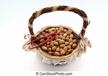 Almonds in a basket with nutcracker