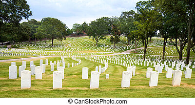 Line of veterans' tombstones at National Cemetery in...