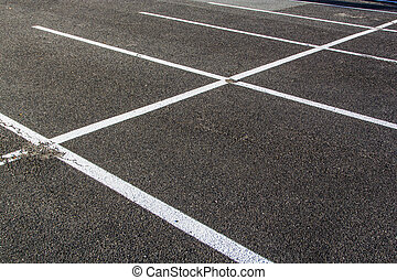 lines for parking lotzs drawn on the asphalt