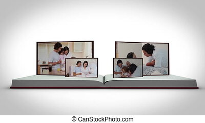 Family videos on a book against a w - Animation of family...