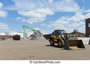 metal recycling factory - different heaps of metal recycled...
