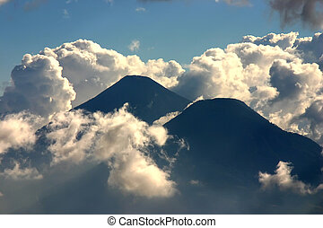 Vulcano in Guatemala - Two volcano in clouds and blue sky