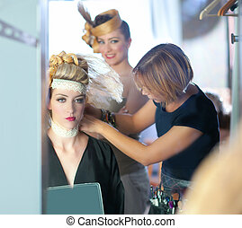 backstage hairdressing fashion with make-up artist -...