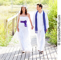 Couple happy in wedding day walking outdoor