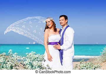 Couple in wedding day on beach sea