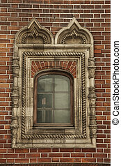 window with ornament in the brick wall