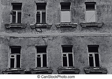 The windows of the old dilapidated city buildings