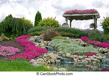 rock garden with waterfalls - Summer rock garden with...