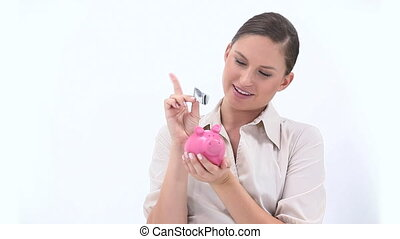 Businesswoman putting banknote in a