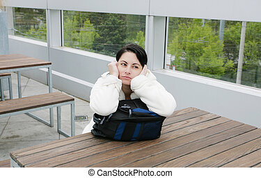Outdoor portrait of a sad woman looking thoughtful about troubles