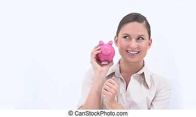 Businesswoman holding a piggy bank - Video of a...