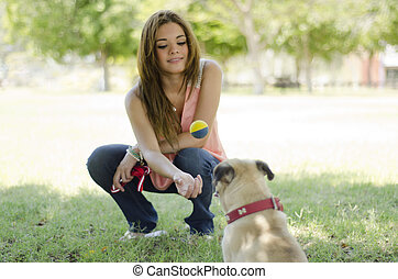 Cute female pet lover and her dog - Young beautiful woman...
