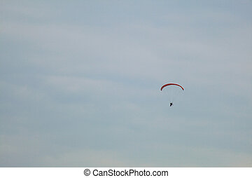 low view of a motor paraglider sky