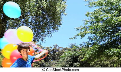 Boy playing with rubber balloon in - Video of a boy playing...