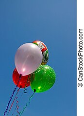 Party balloons. - Bunch of balloons against a blue sky.