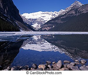 Lake Louise, Alberta, Canada - View across a part frozen...