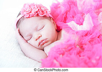 sleeping small princess in pink laces the newborn girl