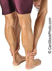 Hamstrings stretch - Lean athletic man performing standing...