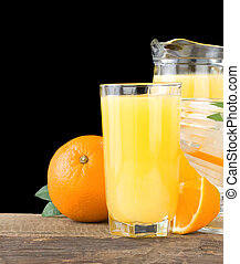 orange fresh fruits and juice in glass isolated on black