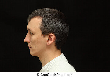gray hair - portrait of a man with gray hair on a black...