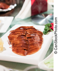 Peking duck skillfully cut and reassembled - Traditional...