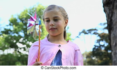 Girl looking at a pinwheel - Video of a girl looking at a...
