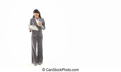 Business woman reading a newspaper - Video of a business...