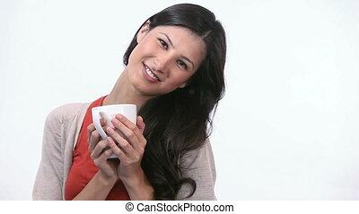 Woman smelling a mug - Video of a woman smelling a mug