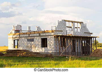 House under construction on a greenfield
