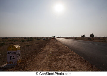 Desert road towards Jaisalmer India - Desert road in the...