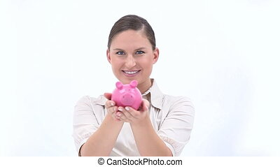 Happy woman holding a piggy bank