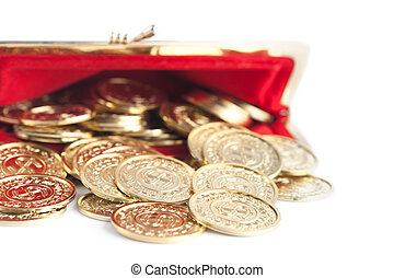 Scattered silver and gold coins are in open red purse,...