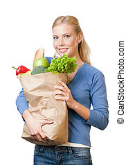 Attractive woman with a bag full of healthy food -...