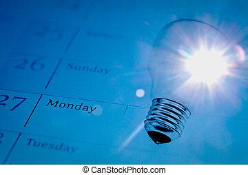 time for innovation: lightbulb on calendar with sunlight