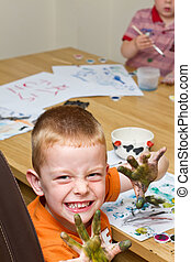Little boy painting a picture - young boy painting a picture...