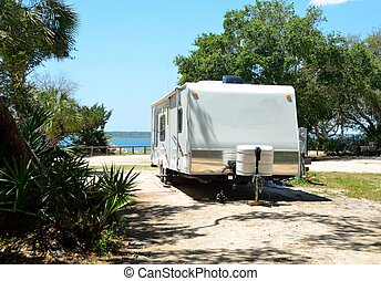 Rv Camping Life - Rv camper parked along the river's edge at...