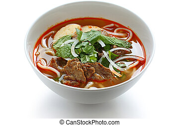 bun bo hue - a bowl of beef & rice vermicelli soup,...
