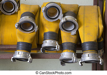 Zoomed yellow firehose are hanging in warehouse - Zoomed...