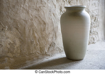 Hand maded and smoothed vase in room corner